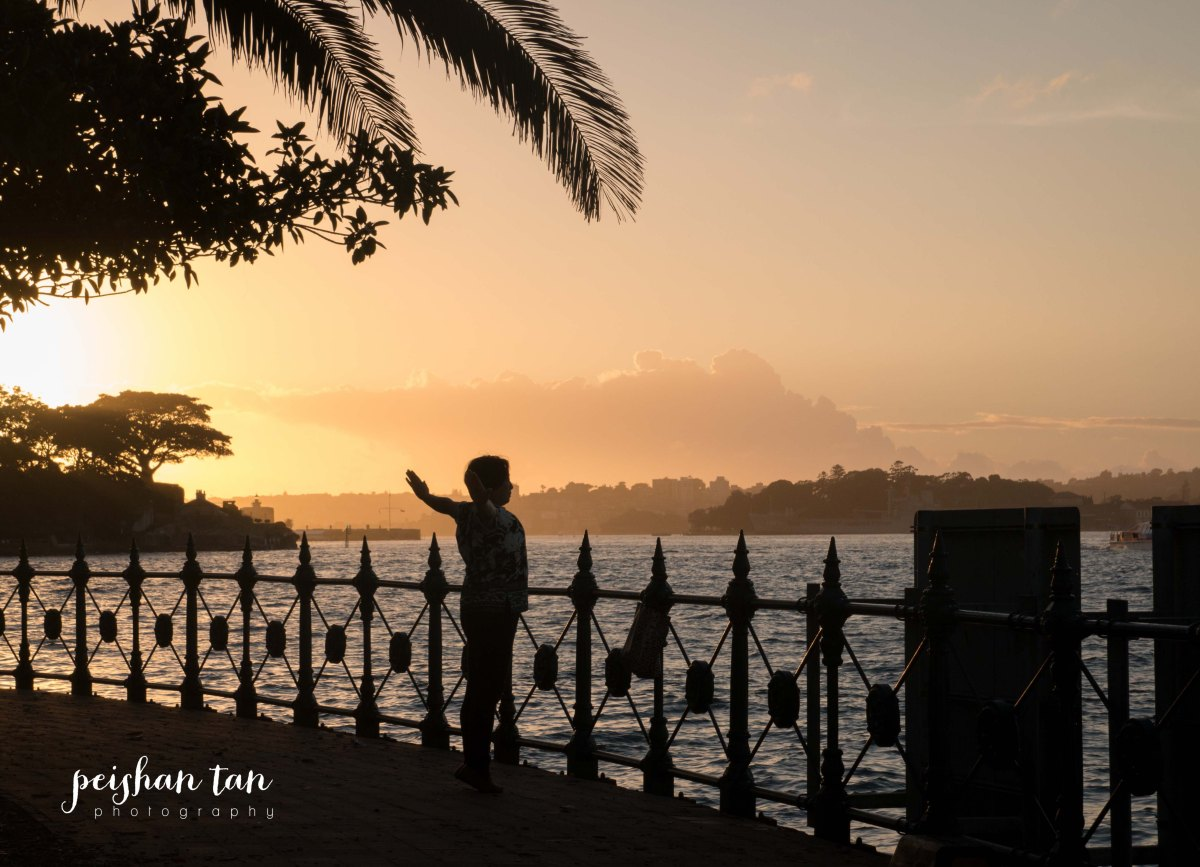 This lady was one of dozens enjoying and exercising in the early morning light