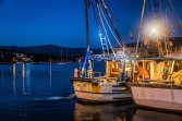 Fishermen hauling in their catch in Rogoznica at twilight