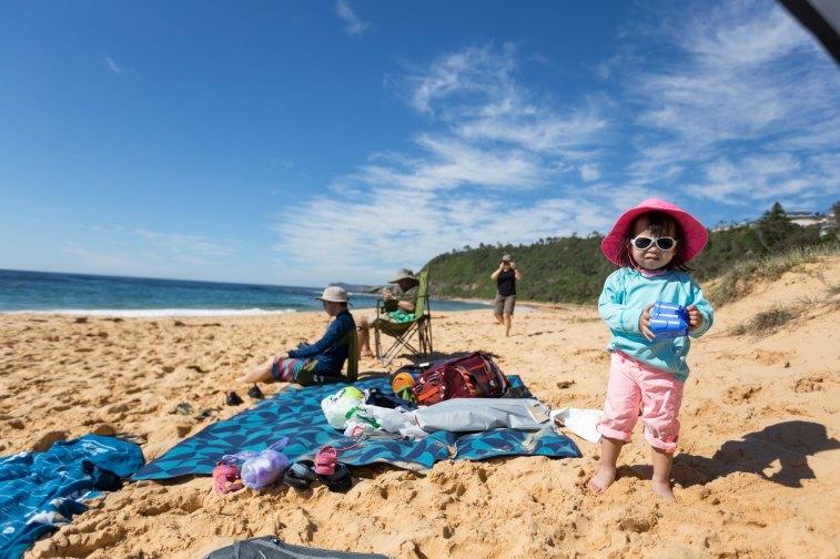 enjoying her first beach experience - forresters beach