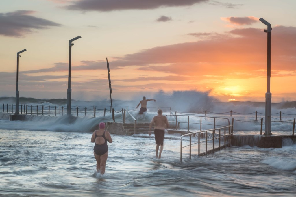 Swimmers braving the waves for a wake up dip